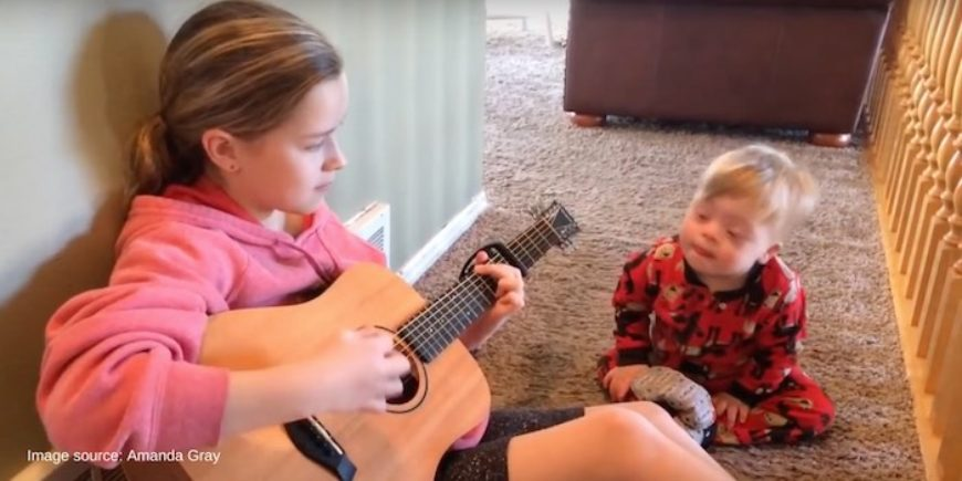 Girl sings to brother with Down syndrome